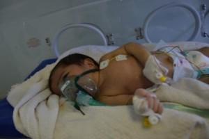 Iraqi baby in Fallujah. Credit: Donna Mulhearn.