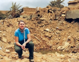 In front of the rubble