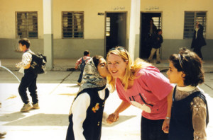 Donna Mulhearn is kissed by a Baghdad schoolgirl a day before the 2003 invasion. Credit: Donna Mulhearn.