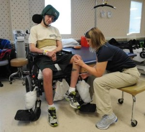 Staff Sgt. Cory Remsburg undergoing therapy for a brain injury he received from an IED blast in Afghanistan in 2009.