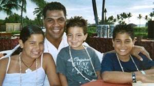 The late Junior Seau and his children in better times. Seau, a former NFL linebacker, killed himself last year. A postmortem diagnoses found he was suffering from a brain disease caused by too many blows to the head.