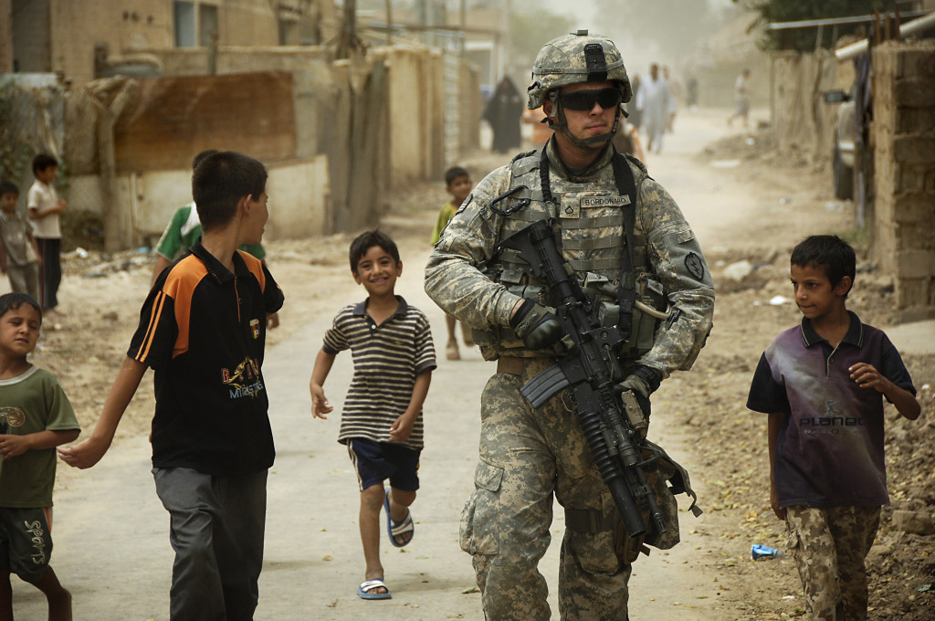 U.S. Army Pfc. Shane Bordonado patrols the streets of Al Asiriyah, Iraq, on Aug. 4, 2008
