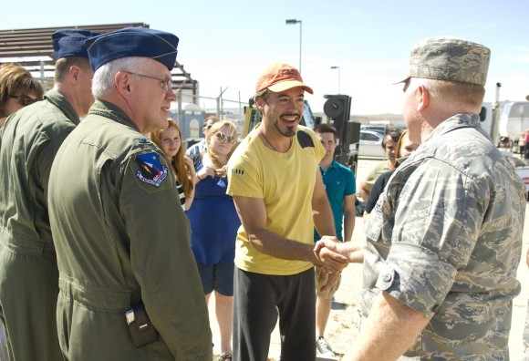 Robert Downey Jr. greets Col. Jerry Gandy, 95th Air Base Wing commander on the set of Iron Man II, which the Pentagon backed.