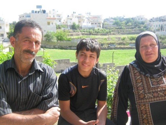 Zein Abu-Mariya (17) with his parents after nine months in Israeli custody. Credit: Pierre Klochendler/IPS.