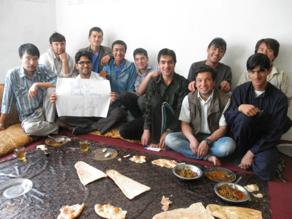 Afghan Peace Volunteers with a sign that thanks Bradley Manning. Credit: Hakim