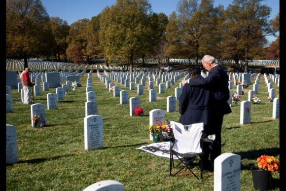 Vice President Joe Biden grieves at the grave a soldier at Arlington National Cemetery, Nov. 11, 2010.