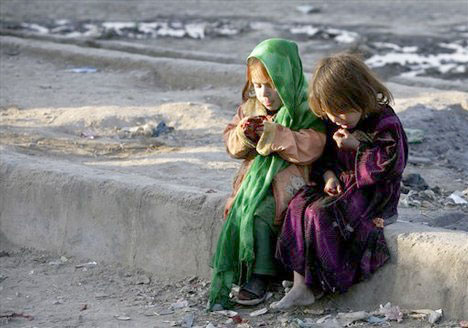 Two Afghan girls eat pomagrantes in Kabul 2010