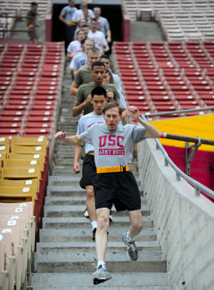 Former Gen. David Petraeus leads college kids in a run at University of Southern California where he landed a new post