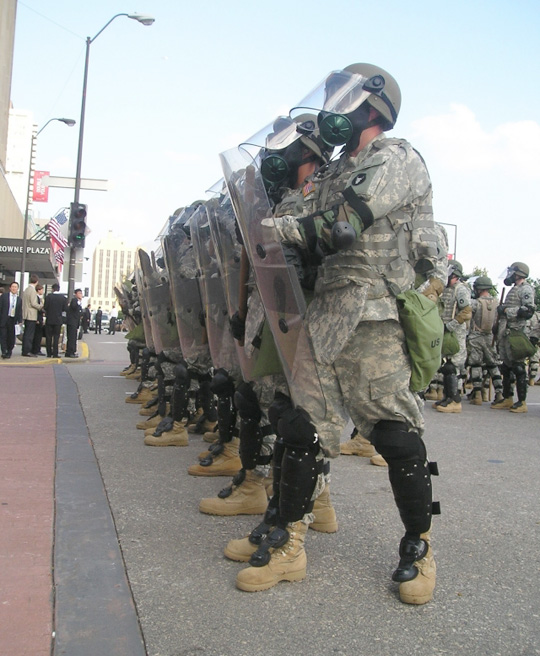 Martial law is not obvious to most people most of the time in the U.S., but military presence was evident on the streets, rooftops, and riverfront in St. Paul during the 2008 RNC political convention. Military was also used for crowd control at the DNC convention in Denver that year. Photo: Army News Service.